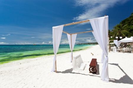 bahamas celebration: Wedding arch decorated on tropical beach