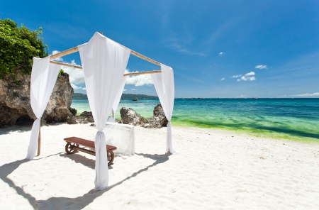 bahamas celebration: Wedding arch decorated on caribbean beach