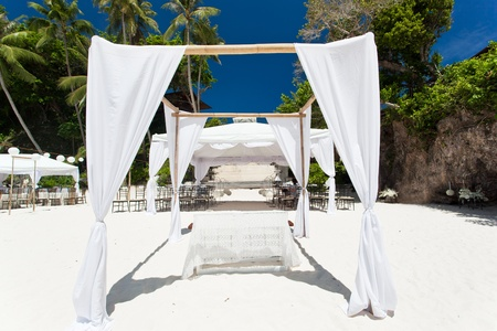 bahamas celebration: Wedding arch decorated on beach