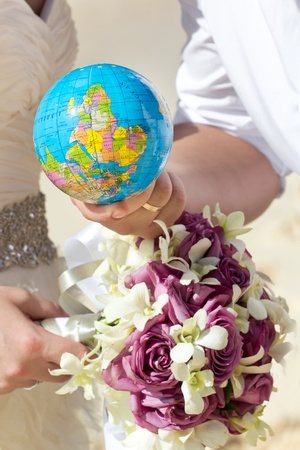 Globe in hand, wedding concept photo