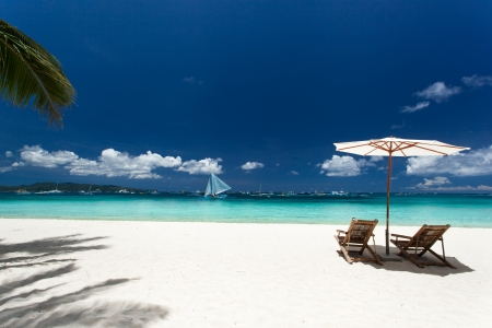 Sun umbrella and beach chairs on tropical beach, Philippines, Boracay