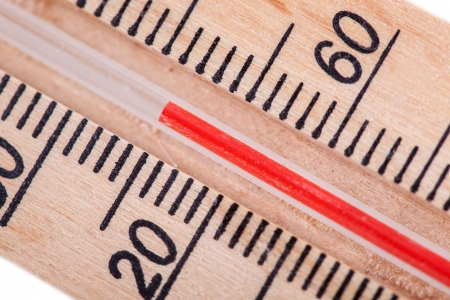 atmospheric: Atmospheric wooden thermometer closeup  Stock Photo