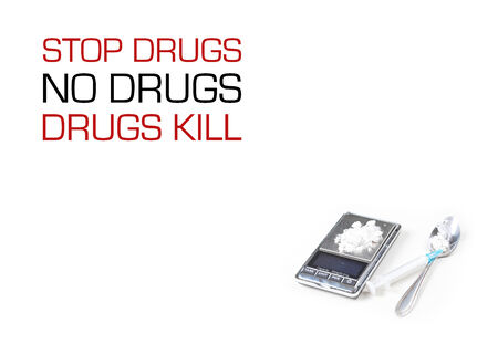 Syringe and digital scales with drugs closeup on white  photo