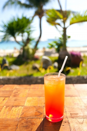 Fruit shake cocktail with ice, tropical vacation photo