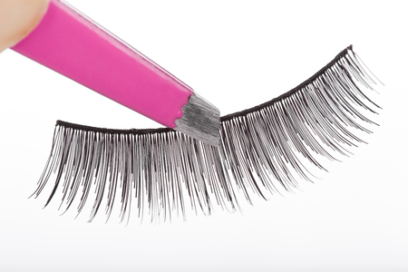 fascicle: False lashes and pink pincers, closeup on white background