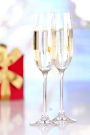 Pair glasses of champagne and present box, closeup  photo