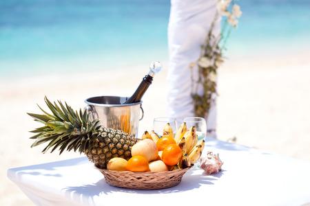 bahamas celebration: Wedding tropical celebration, fruit plate and champagne, ceremony on beach