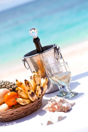 Wedding tropical celebration, fruit plate and champagne, ceremony on beach photo