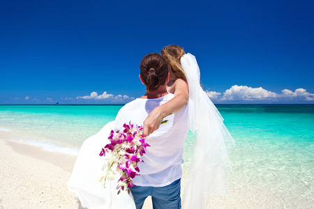 Exotic tropical wedding on ideal sandy beach. Travel wedding  photo