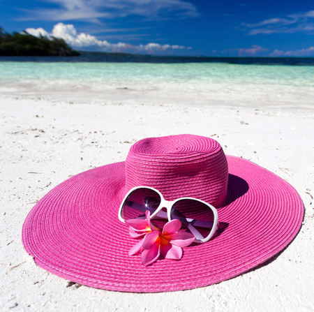 pink hat: Pink hat on tropical beach