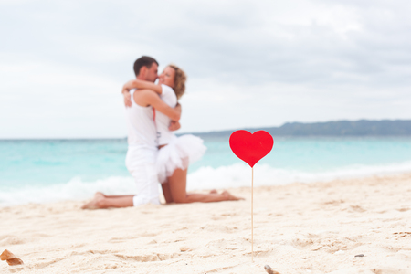 Summer Love on tropical beach, focus on heart photo