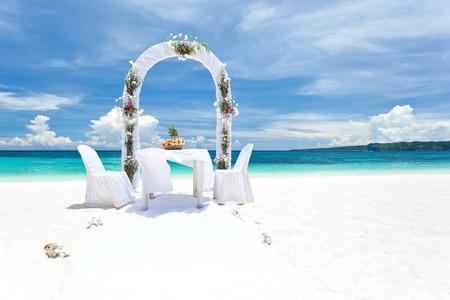 Beautiful wedding arch on tropical beach, nobody. Travel wedding 스톡 콘텐츠
