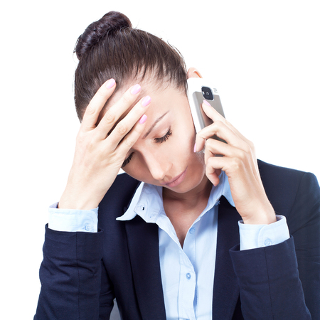 Disappointed business woman talking on the phone in office Stock Photo - 24973509