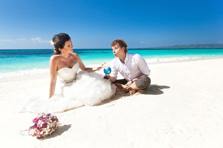 Travel wedding concept. Couple on the beach photo