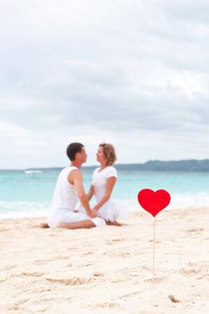 Summer Love on tropical beach, focus on heart photo