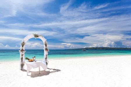 Beautiful wedding arch on tropical beach, nobody. Travel wedding photo