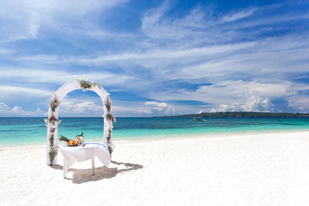 Beautiful wedding arch on tropical beach, nobody. Travel wedding Stock Photo