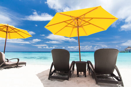 longue: Sun umbrellas and chairs on beach