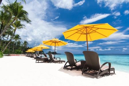 Sun umbrellas and chairs on beach