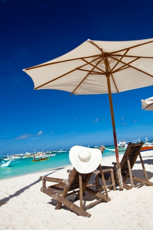 Sun umbrella with chair longue on tropical beach  photo