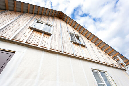 building external: External wall insulation in wooden house,  building under construction Stock Photo