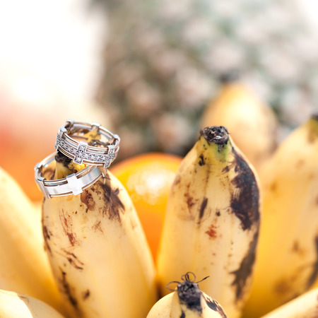 Wedding gold rings on bananas fruit, wedding in tropics photo