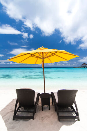 Sun umbrellas and chairs on caribbean beach photo