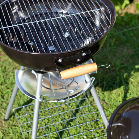 Kettle barbecue grill in summer garden, outside, nobody