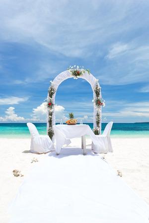 Beautiful wedding arch on tropical beach photo