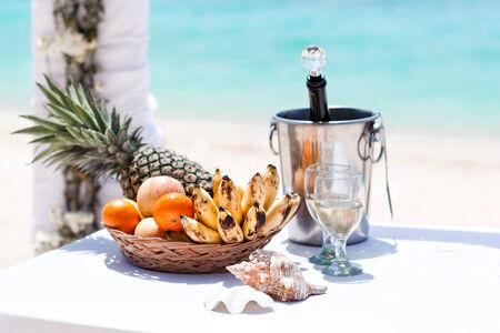 Beautiful wedding decoration with champagne on beach photo