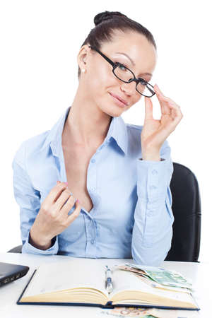 Flirting businesswoman on workplace with glasses in hand