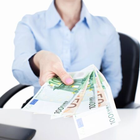 reach out: Businesswoman reach out euros in hand Stock Photo