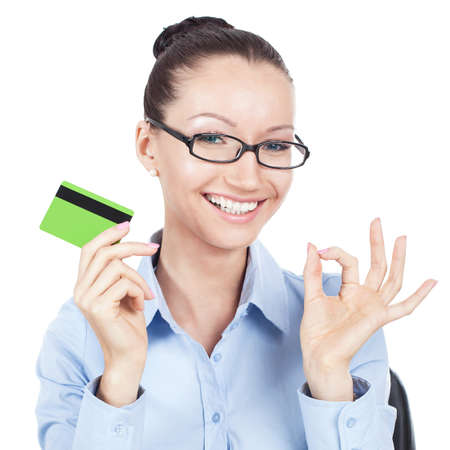 smilling: Smilling businesswoman on workplace with credit card in hand