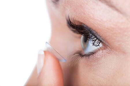 Woman eye with contact lens applying photo
