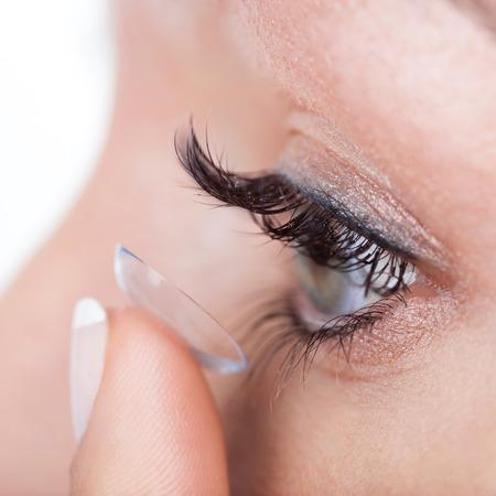 Woman eye with contact lens applying, macro Stock Photo