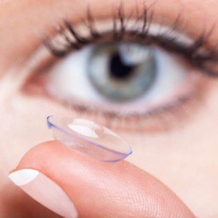 Woman eye with contact lens applying, macro Stock Photo - 27098343