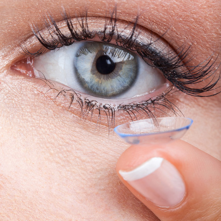contact lens: Woman eye with contact lens applying, macro Stock Photo