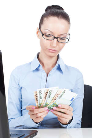 Business woman at office with euros in hands  photo