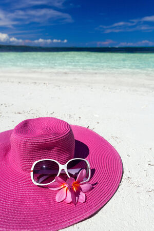 Pink hat on tropical beach photo