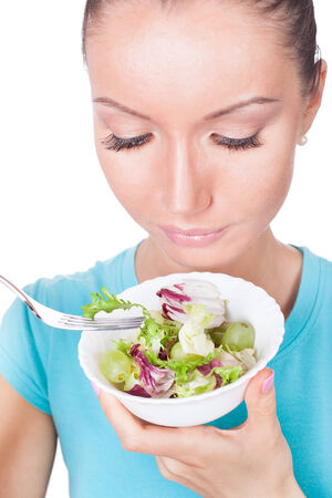 Woman eating salad, diet concept photo