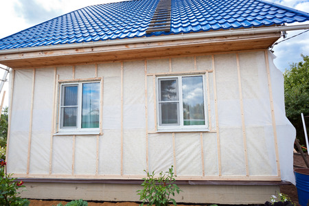 External wall insulation in wooden house,  building under construction photo