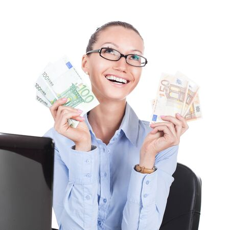 smilling: Smilling businesswoman on workplace with euros in hands  Stock Photo