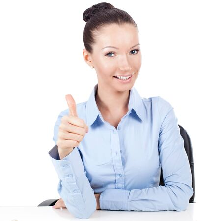smilling: Smilling businesswoman on workplace doing gesture thumbs up  Stock Photo