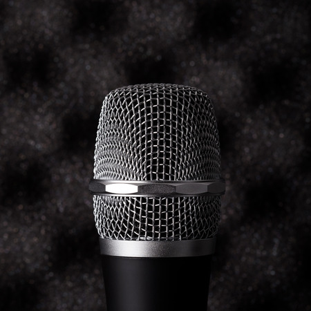 noise isolation: Wireless microphone closeup on foam rubber acoustic treatment background Stock Photo