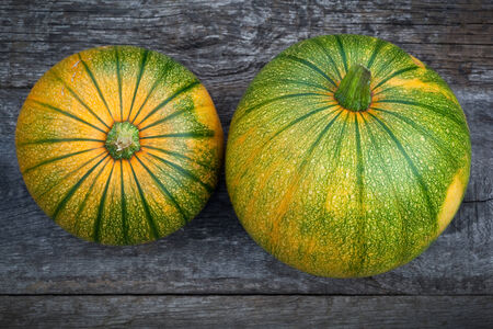 wooden table top view: Fresh pumpkins  on wooden table, top view