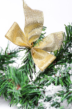 Decoration golden billow on new year tree branch in snow photo