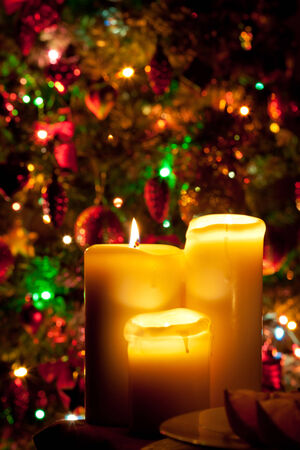 Christmas candles on fir tree lights background photo