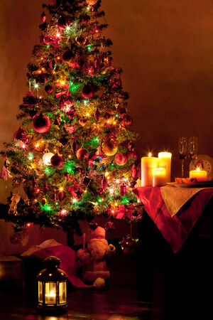 Lighted decorated Christmas tree in living room photo