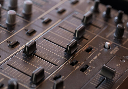 crossfader: Dj sound mixer  with knobs and sliders, closeup
