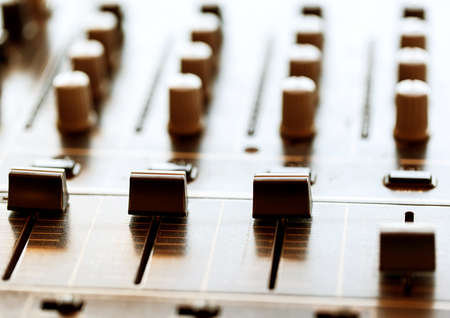 fader: Sound mixer controller with knobs and sliders, closeup Stock Photo